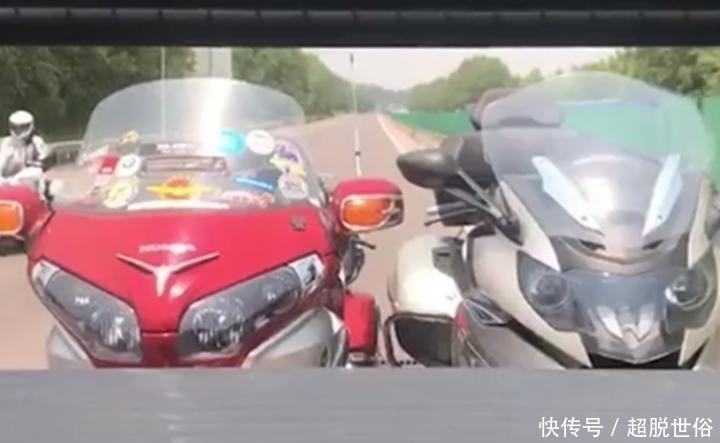 高速实拍国宾650摩托车,车价6万,车主戴盔上牌靠右行驶很守规矩!