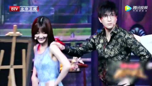 毛晓彤教薛之谦《拉丁舞》表情呆萌。